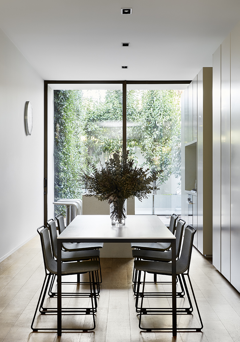 dining room with big windows and table and chairs