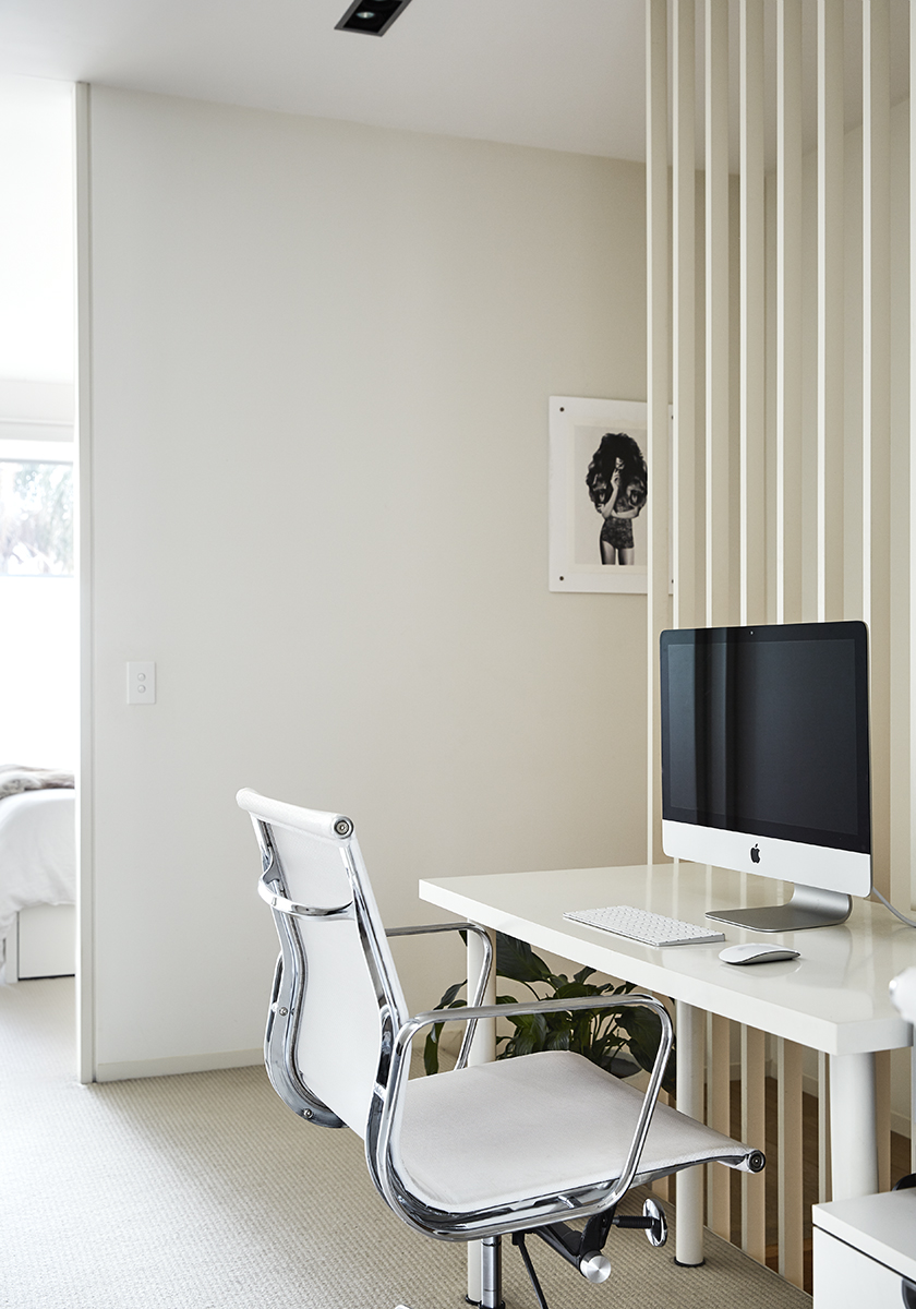 white desk and office chair with a mac computer