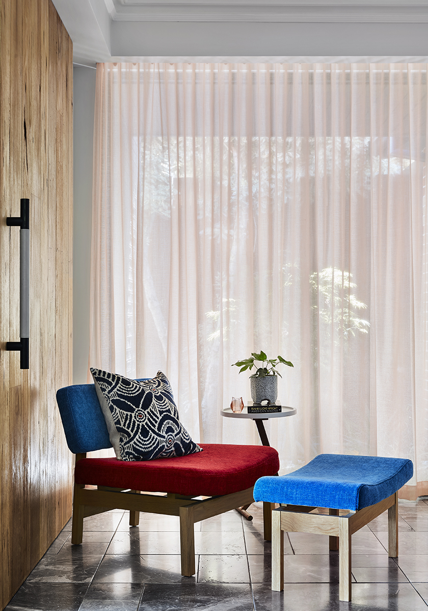 red blue and timber chair with black pillow
