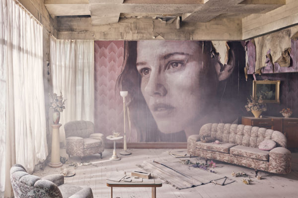 living room with couches and curtains and woman painted on the wall