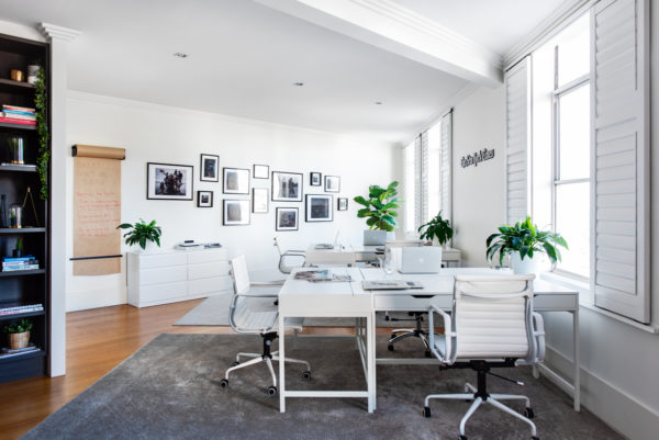 small white office space with desks and chairs
