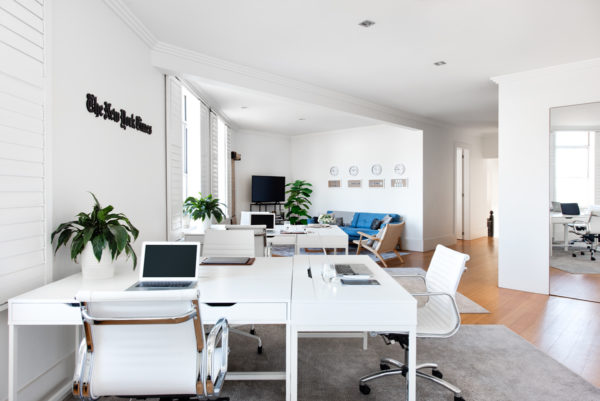 open office space with white desks and chairs