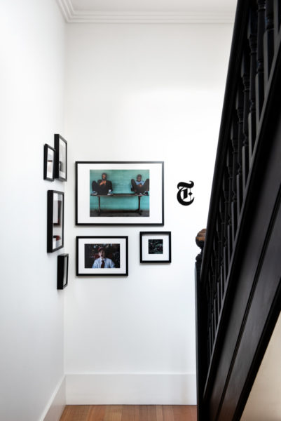 black staircase with framed pictures on the wall