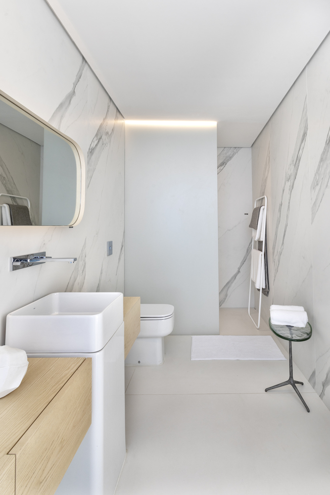 bathroom with white marble walls