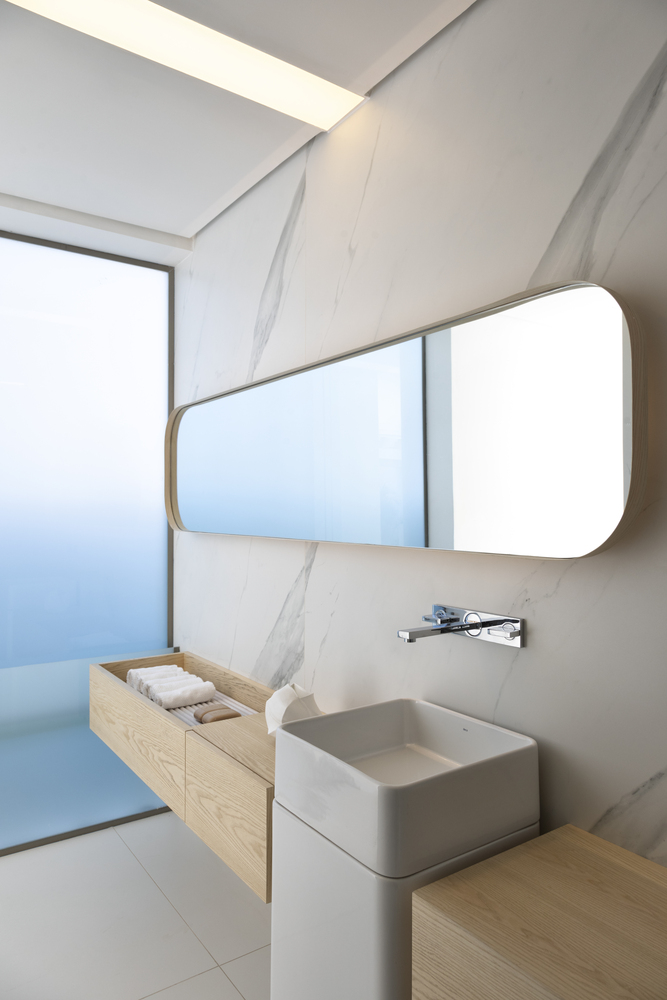long rectangular bathroom mirror with timber vanity