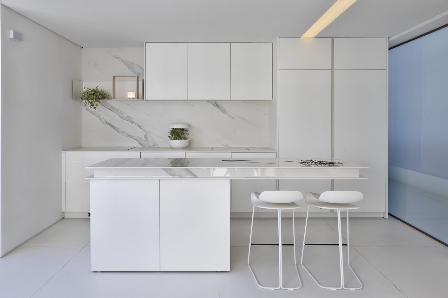 small white modern kitchen with marble finishes